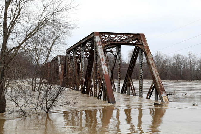 A flooded bridge after the recent deluge in the Midwest. Photo courtesy of Army Corps of Engineers.