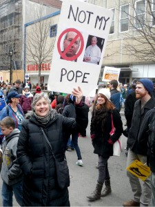 Anti-Pope protester at 2014 Moral March. Photo by Barry Yeoman.