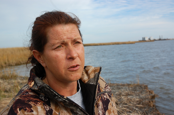Darla Rooks in Bay Jimmy, one of the areas most hard hit by the BP oil spill. Photos by Barry Yeoman.