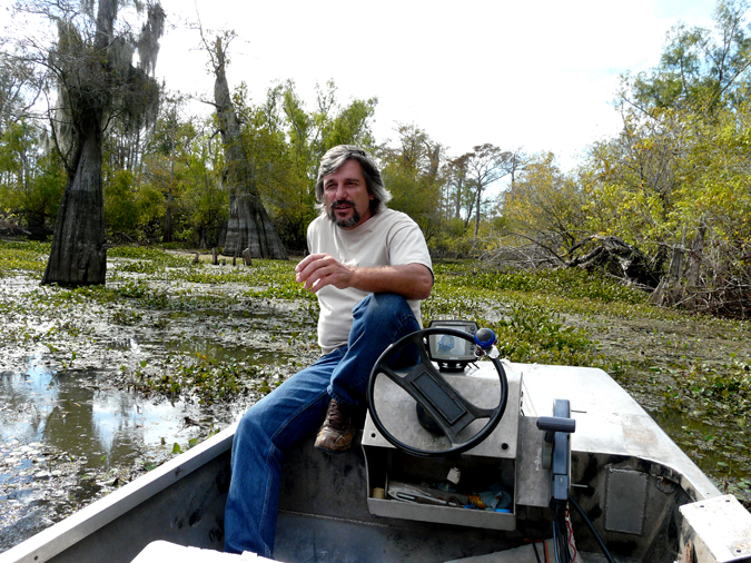 Dean Wilson in the Atchafalaya Basin, a 1.4-million-acre landscape that includes the nation's largest river swamp, provides phenomenal wildlife habitat. Photos by Barry Yeoman.