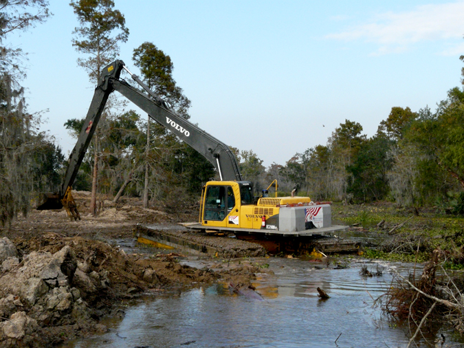It may not look pretty now, but this process will turn a manmade mess back into more natural marsh land. Photos by Barry Yeoman.